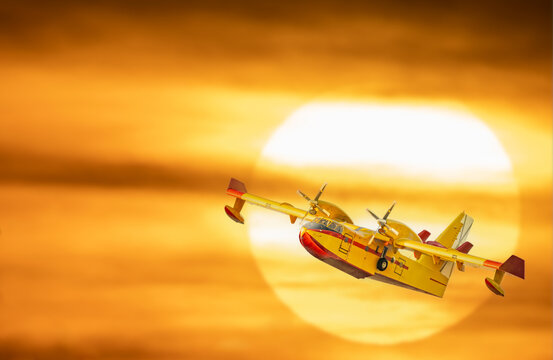 Hydroplane flying over huge sun in the background