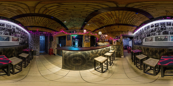 GRODNO, BELARUS - NOVEMBER, 2018: Full spherical seamless panorama 360 degrees in interior stylish nightclub bar in basement with arches in equirectangular equidistant projection. VR content
