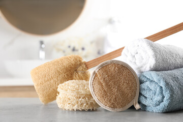 Wall Mural - Natural loofah sponges and towels on table in bathroom
