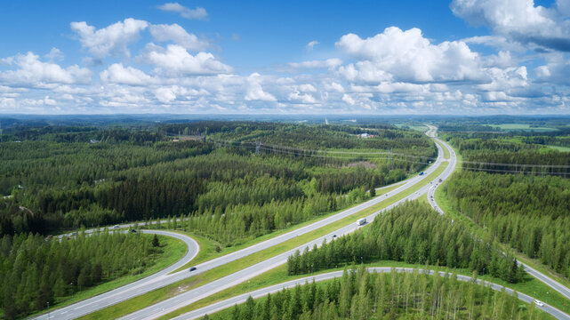 Summer rural landscape, aerial view. View of green forest and highway. Finland.