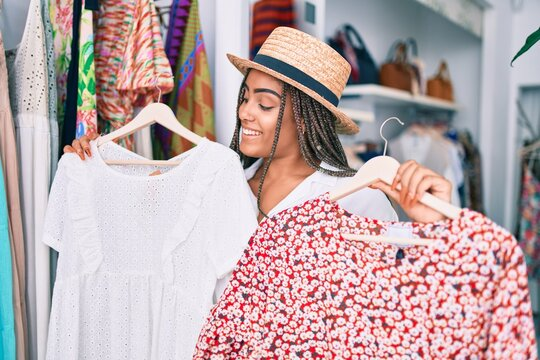 Young african american woman smiling happy at retail shop