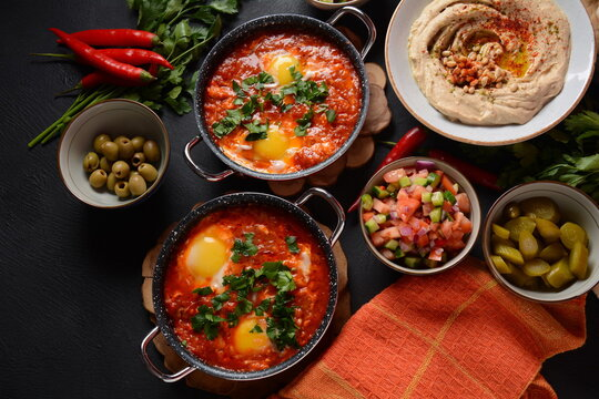Shakshouka, eggs poached in sauce of tomatoes, olive oil, peppers, onion and garlic, Mediterranean cuisine