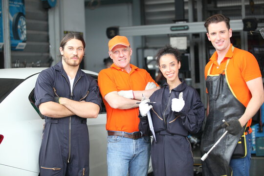 Portrait of a mechanic at work in his garage or car repair service or auto store, business, maintenance and people concept