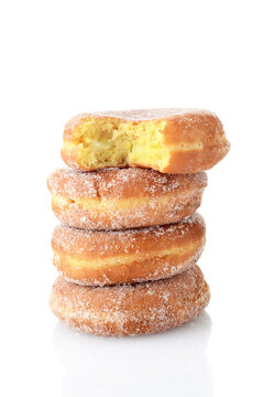 bite missing from stack of paczki donuts