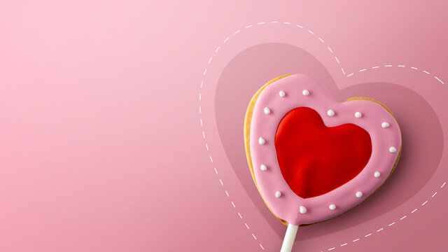 happy valentine's day concept. heart shaped cookies on pink background. space for text. flat lay. top view