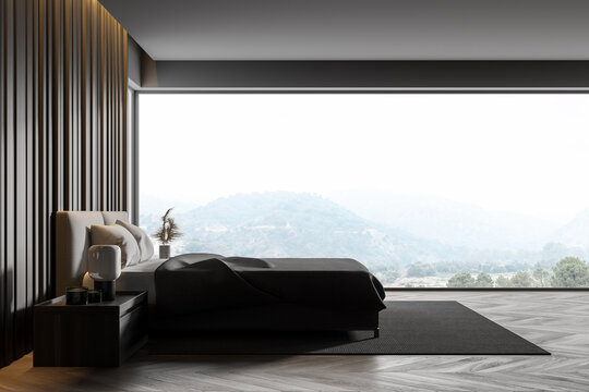 Master bedroom with grey wooden walls, panoramic window with countryside view, comfortable king size bed standing on gray carpet and wooden parquet floor. 3d rendering