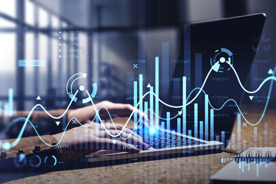Businesswoman hands or stock trader analyzing stock graph chart by fibonacci indicator using laptop to buy or sell stock, double exposure graph, internet trading