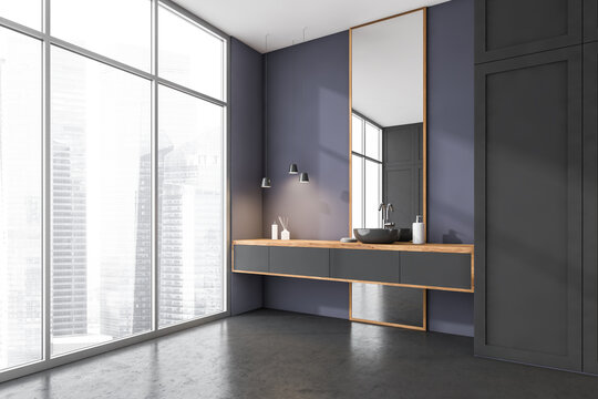 Corner of modern panoramic bathroom with gray tiled walls, concrete floor, double sink standing on wooden countertop with square mirror and window with blurry cityscape. 3d rendering