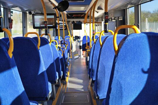 The public transport bus inside view .