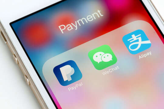 Portland, Oregon, USA - Oct 18, 2019: PayPal, WeChat Pay and Alipay mobile app icons are seen on a smartphone.