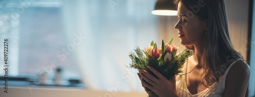 A bouquet of flowers in the hands of a woman. International Women's Day