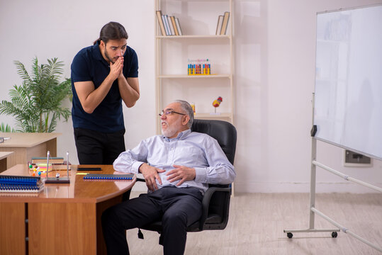Old male teacher feeling bad during individual lesson