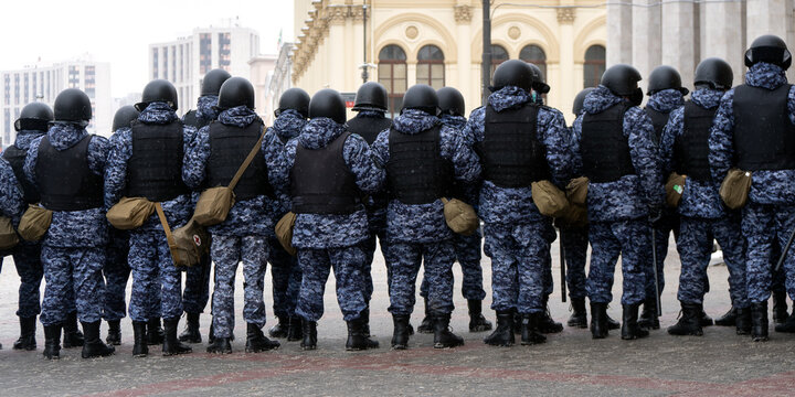 Police officers stand in a cordon on unauthorized political rally in support of the arrested opposition leader Alexei Navalny on january 31, 2021 on Komsomolskaya Square in Moscow . Rear view.