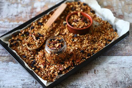 Homemade granola on a baking sheet. Super healthy breakfast.