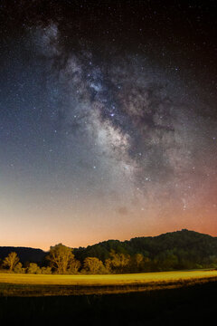 Beautiful scenery of the Milky Way galaxy in the night sky over a landscape