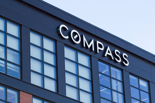 Seattle, WA, USA - Oct 11, 2019: The Compass sign is seen at Compass Seattle Office. Compass is an American real estate technology company.