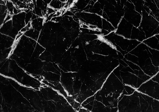 Marble black luxury tile with abstract white pattern of cracks grunge wall texture background
