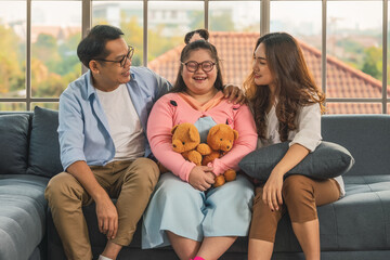 asian family with down syndrome teenager daughter have fun together