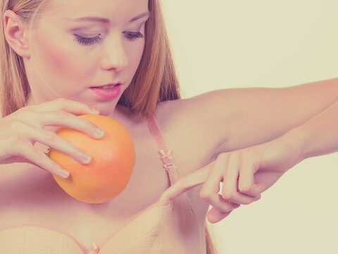 Woman small boobs puts big fruit in her bra