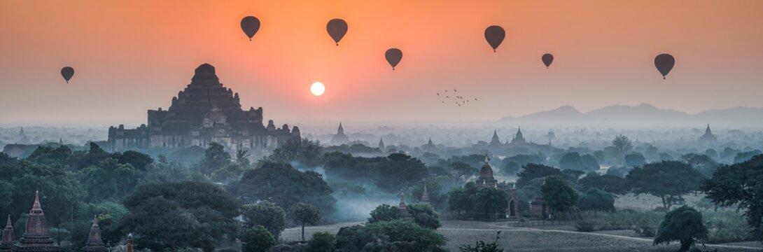 Dhammayangyi Temple and hot air balloons at sunrise, Bagan, Mandalay Region, Myanmar