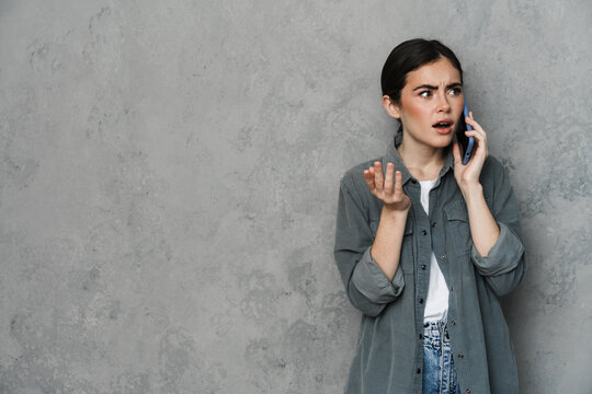 Annoyed woman having negative conversation