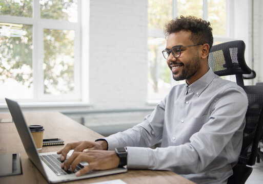 Confident businessman working on laptop at his workplace at modern office, Young handsome student men using laptop computer, Business, working moments, freelance, distance education concept