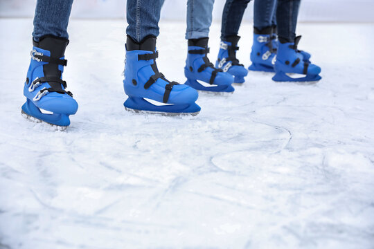 Friends at ice skating rink outdoors, closeup. Space for text