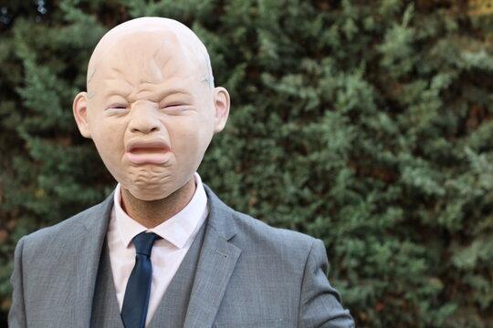 Spooky senior bald businessman crying