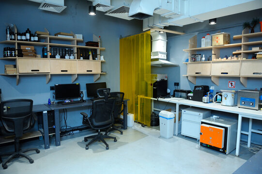 Joinery shop at the fabricator lab: boring mill, sawing machine, sanding machine and tools on a stand