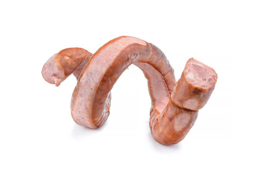 Smoked sausage twisted in a spiral and bound with a beechnut, isolated on a white background.