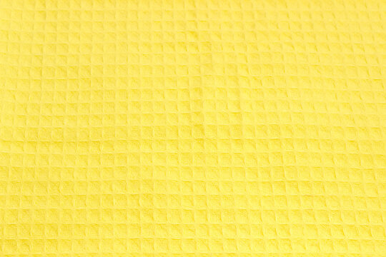 Texture of the fabric of yellow cotton waffle towel