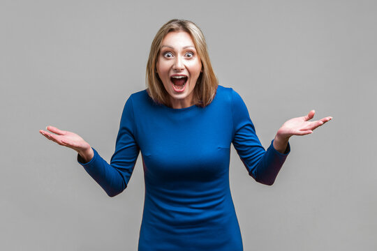 Wow, unbelievable! Portrait of positive astonished woman with widely open mouth and big eyes looking at camera, shocked by success, sudden great news. indoor studio shot isolated on gray background