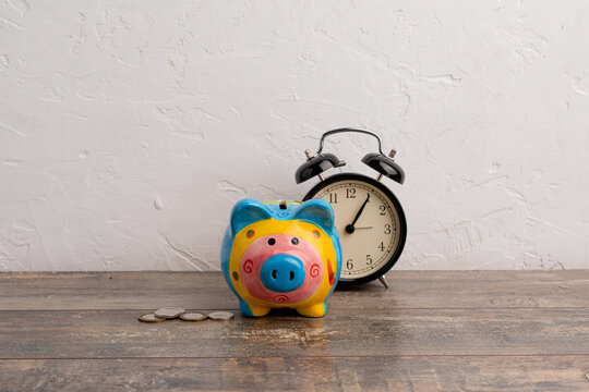 Calendar date of the end of the fiscal year, for the tax year or retail sales of stocks, with a piggy bank and calculator on a light background, with a copy space.
