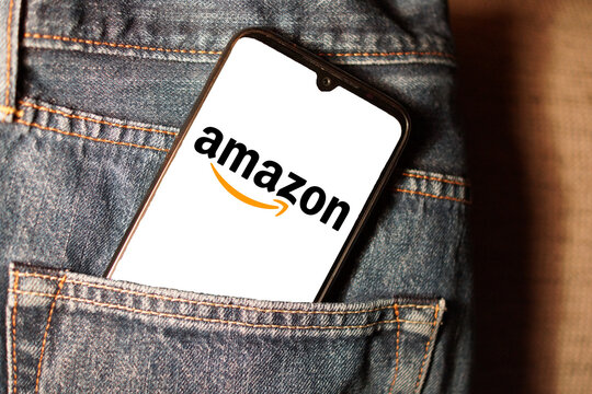 LEIPZIG, GERMANY - Jan 21, 2021: Logo of amazon on a smartphone display in a jeans pocket