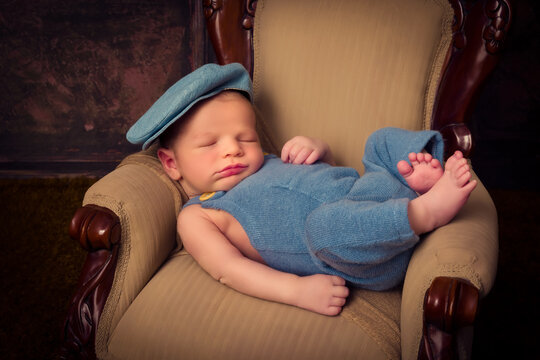 Baby napping on armchair