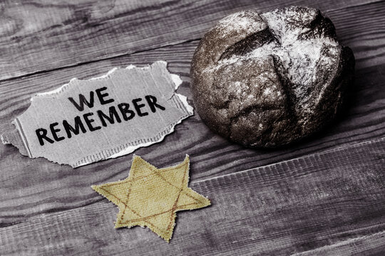 bread, star of david and the inscription we remember on a wooden table