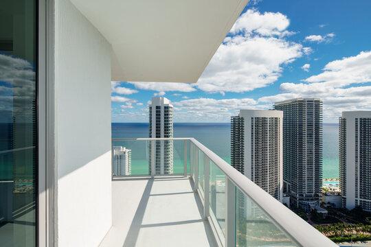 Luxury condo balcony with coastal ocean water view