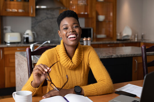 Portrait of african american woman smiling while working from home
