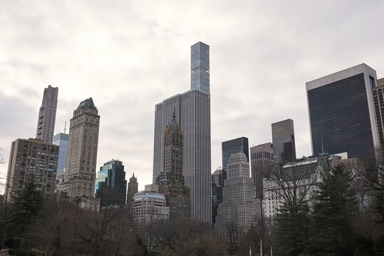 Low angle of modern skyscrapers on background of cloudy sky in Manhattan in New York