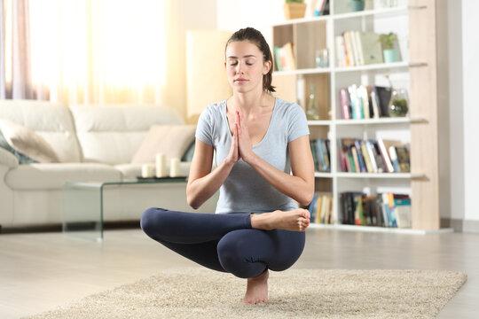 Yogi exercising yoga pose at home