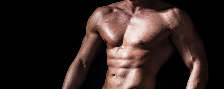 Sexy torso. Handsome big muscles man posing at studio. Muscular sexy man. Handsome sexual strong man with muscular body. Torso with six pack and ab muscle. Abs and biceps. Strong brutal guy