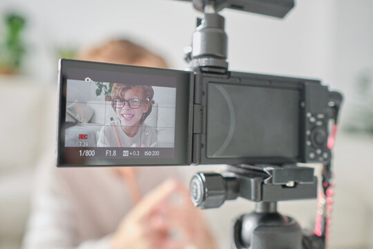 Preteen boy recording video at home for his channel.