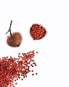 Organic achiote seeds on white background - Bixa Orellana