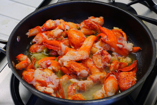 Sauteeing lobster meat in a pan