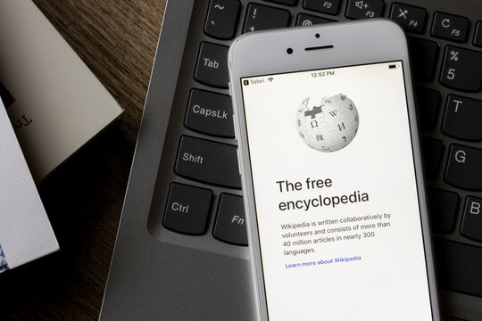 Portland, OR, USA - Feb 1, 2021: The welcome page of Wikipedia app is seen on an iPhone. Wikipedia is a free online encyclopedia, created and edited by volunteers and hosted by Wikimedia Foundation.