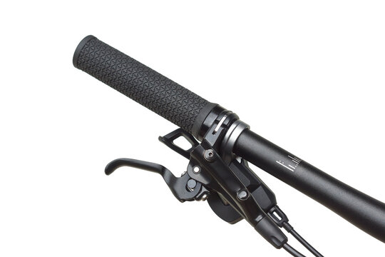Handlebar of a mountain bike with brake, gear shifter, and a grip isolated