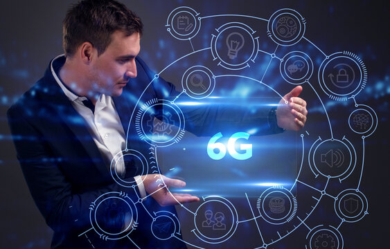 Business, Technology, Internet and network concept. Young businessman working on a virtual screen of the future and sees the inscription: 6G