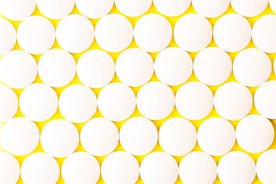 Image of a drug, pill, or remedy. On yellow background paper.