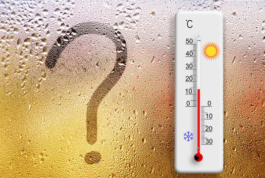 Rainy day. Question mark symbol written on glass. Thermometer for measuring air temperature shows plus 14 degrees