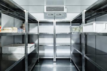 Obraz Refrigerator chamber with steel shelves in a restaurant - fototapety do salonu
